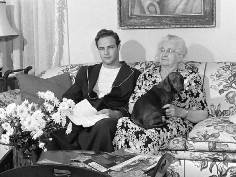 "Marlon Brando with his grandmother and dachshund ""Kurtze Beiner"""