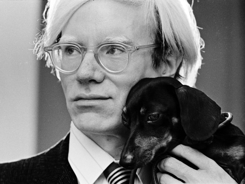 Andy Warhol with his dachshund Archie in 1973